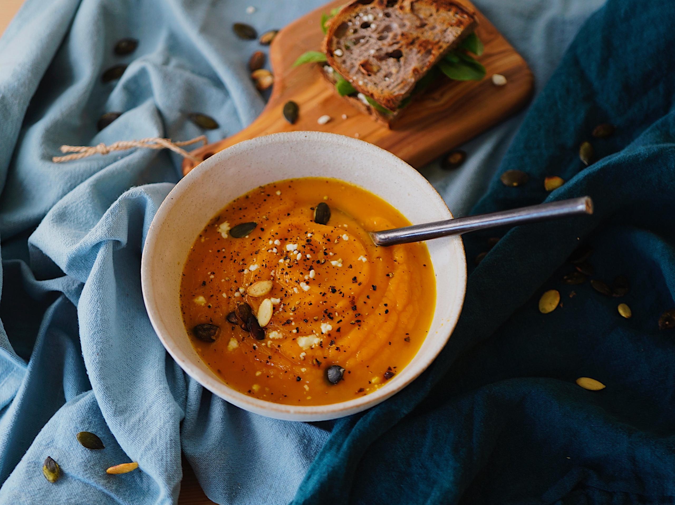 round white bowl of soup on gray textile